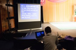 Ruichang Ding, screening the translation of performers' dialogues for the audience. Nov. 2017