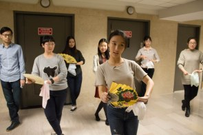 """Shiyu Liu, in the front, teaching a dance class for """"The Romace of the Western Chamber"""" in the hallway of their office located in lower Manhattan. Nov. 2017"""